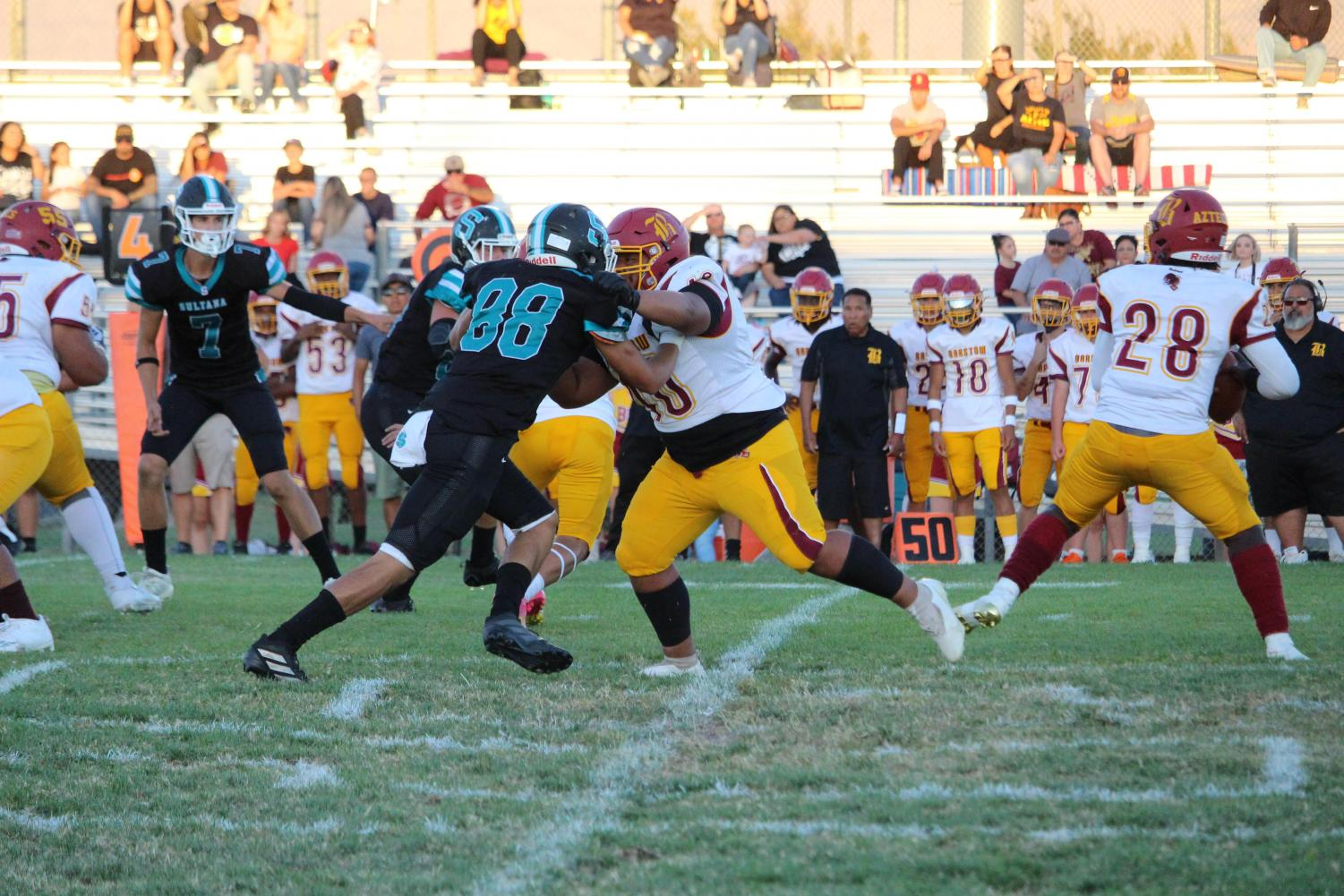 Defensive end, Andre Ruiz, works against the offensive line.